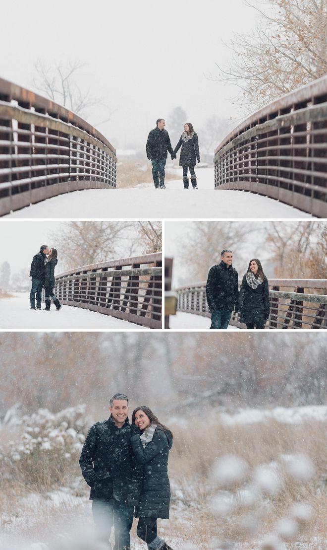 Couple walking to take snowy engagement photos