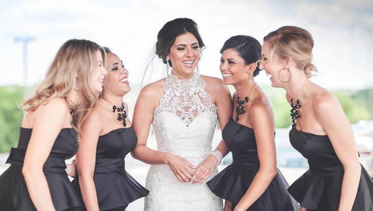 Bride with deep plum bridesmaids
