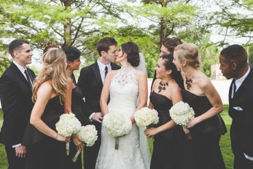 Black and white wedding party at the riverbend chapel