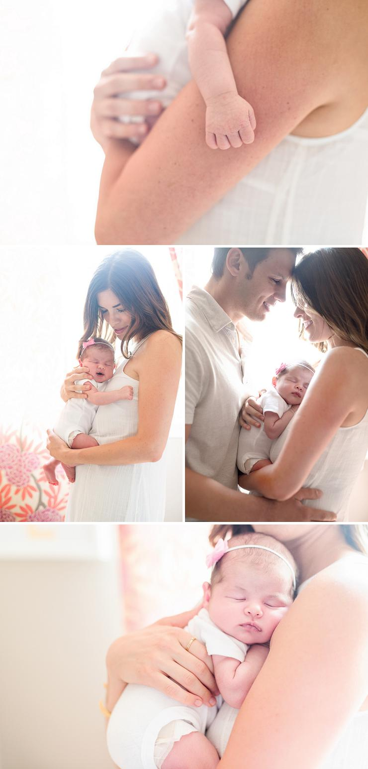 New parents hold baby Sloane in her pink girl's nursery