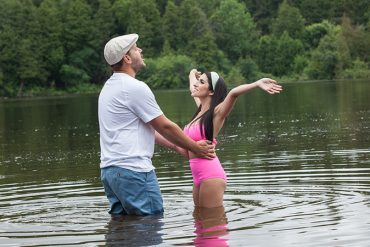 Couple reenacting a scene from the notebook for their engagement photos