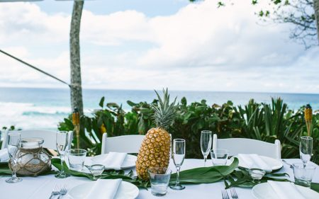 Backyard Hawaii wedding with pineapple centerpiece