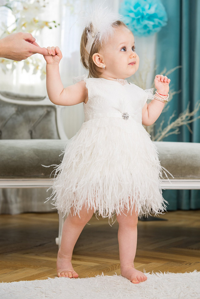 Feather and lace flower girl dress