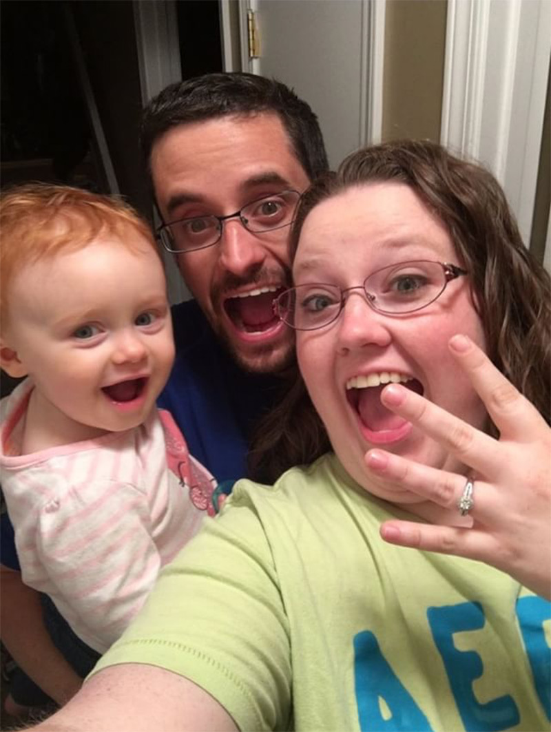 Engagement ring selfie including the whole family