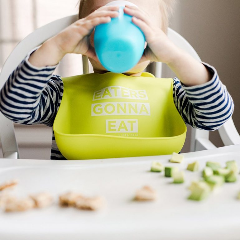 Child wearing Eaters Gonna Eat silicone bib