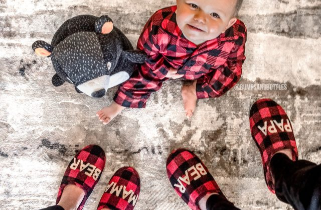 Family with matching Lumberjack red plaid slippers