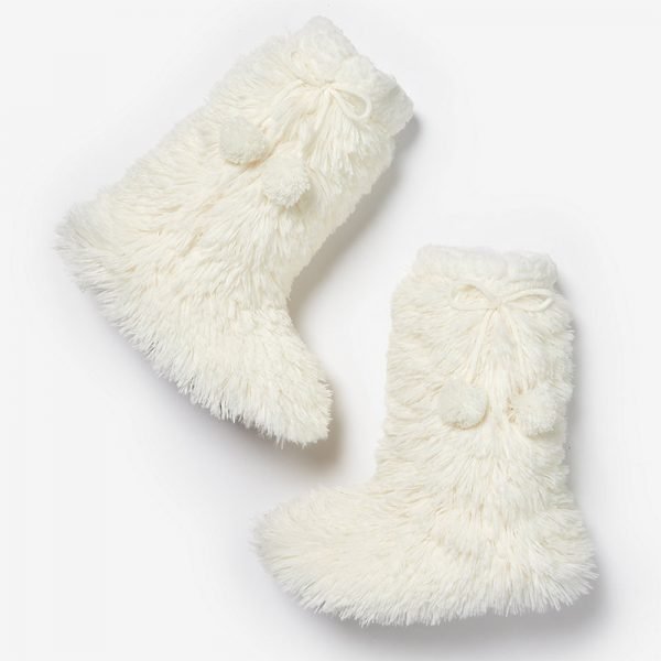 Fuzzy white slipper socks with pompoms from Express