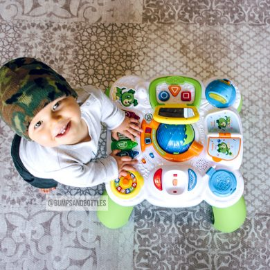 Baby boy playing at his LeapFrog activity table